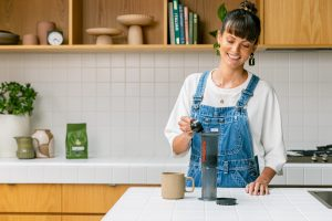 woman making aeropress coffee